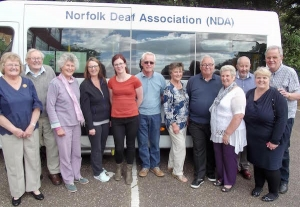 NDA volunteers standing in front of the mobile clinic minibus