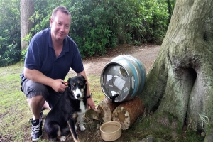 Peter Brough with his dog Pippa at the beer barrel watering station.