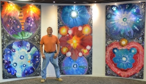 Danny in front of his Triptych, which is being displayed at Cromer Library in October