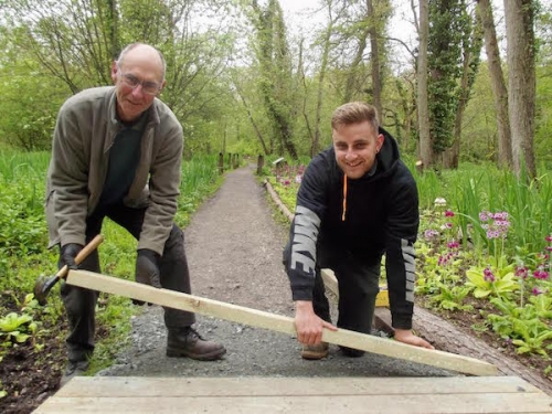 John Debbage (left) and Michael Hadji working on the path renewal project