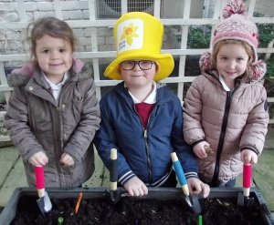 Evie Victoria, Jamie and Emily planting daffodil bulbs